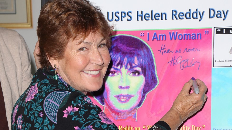 Helen Reddy signing an I Am Woman poster in Hollywood in 2013