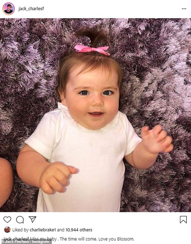 Doting dad: Jack Fincham has revealed he is missing his baby daughter Blossom as he shared a throwback snap of her on Instagram on Tuesday