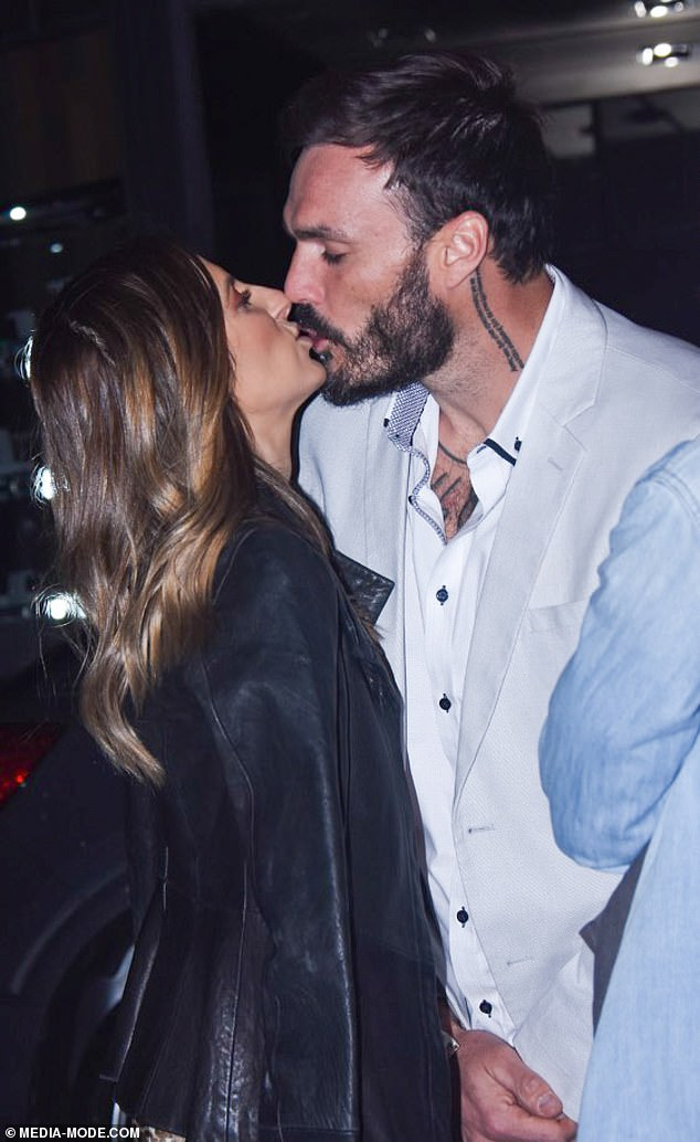 Smitten: The Bachelor's Locky Gilbert and Irena Srbinovska shared a kiss as the pair made their debut as a couple on their first outing after the show's finale on Friday