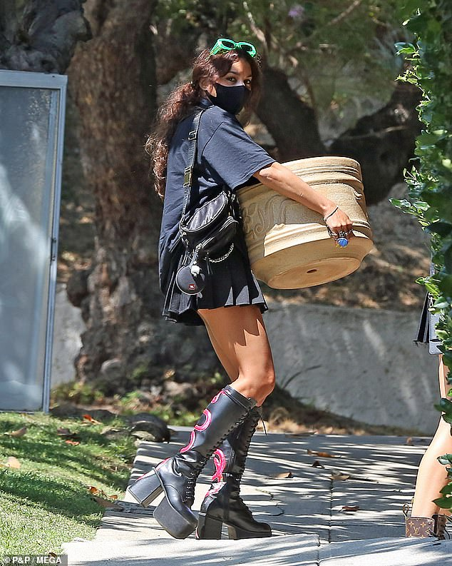 Vanessa Hudgens certainly turned heads in a tiny pleated miniskirt as she left a garden centre in Los Angeles on Tuesday