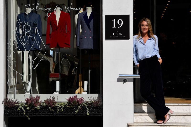 © Reuters. Knatchbull, Founder of The Deck, stands outside of her new premises on Savile Row, the first shopfront tailors exclusively for women to open on the world famous street, renowned for its bespoke clothes making, in London