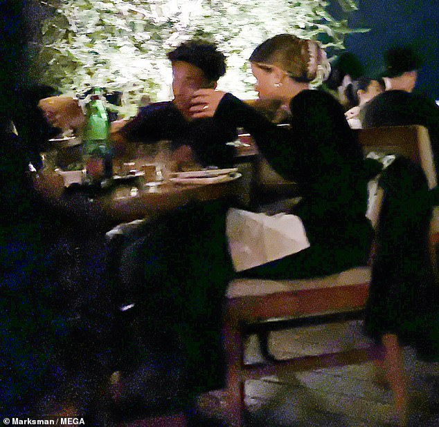 Cozy:The pair, who both happen to be 22-years-old, sat next to one another as they chowed down on their food
