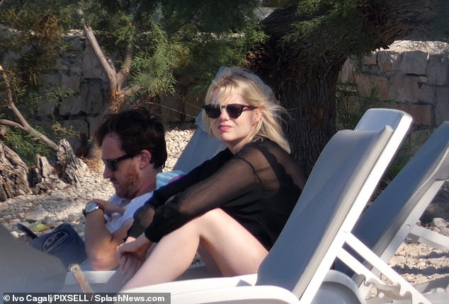 Chic:The actress finished her chic swimwear look with a pair of oversized black sunglasses