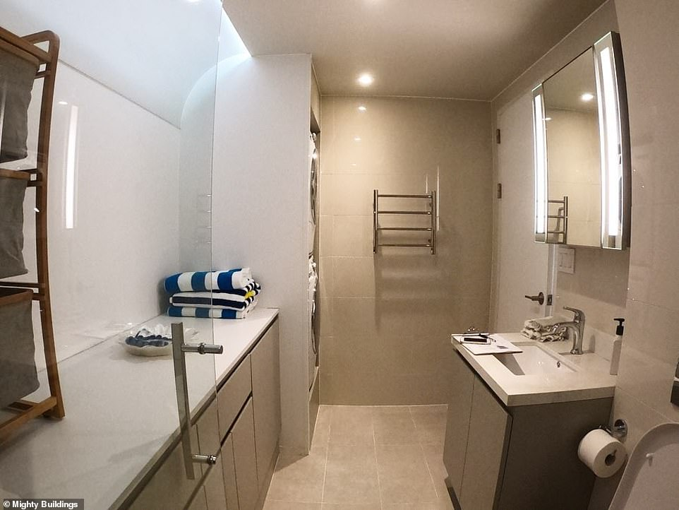 Interior of the 350 square-foot studio from the shower, with the door to the main room on the right. Inhabitants might just want a short-term lease to avoid cabin fever due to the pokey size