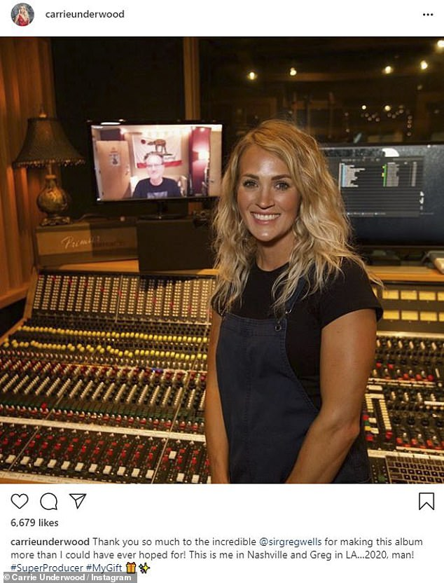 Behind-the-scenes: Carrie also thanked producerGreg Wells, sharing a throwback photo from the recording studio