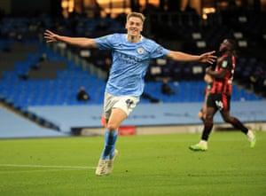 Liam Delap celebrates scoring Manchester City's first goal.