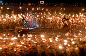 At the Up Helly Aa festival up to 1,000 Viking paraders set a galley ablaze by throwing torches into it.