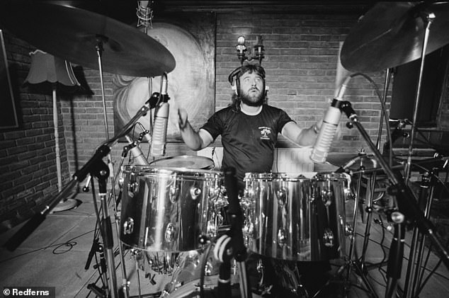 Kerslake began drumming at 11 and first joined the UK band gods. He joined progressive hard rock group Uriah Heep in 1971, before leaving in 1978. He later rejoined from 1981–2007; shown in 1980