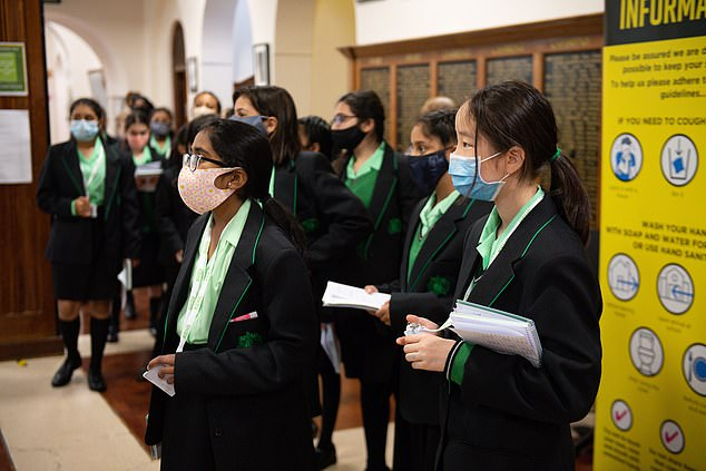 Of 12,026 adults and children, just three tested positive for Covid-19. Two were staff and one was a child. Pictured: Pupils at the King Edward VI High School for Girls in Birmingham, Thursday September 3