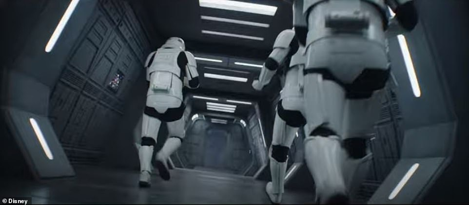 The same old bad guys are at it again: Stormtroopers are seen with their blasters at the ready on a ship