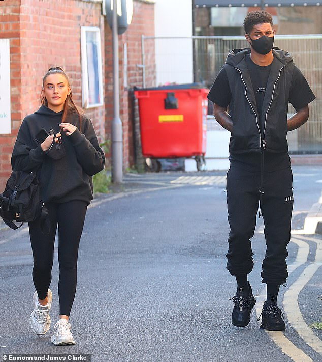 Chic: Lucia Loi, 22, wore a black hoodie and leggings paired with white trainers and wore her brunette locks in a sleek ponytail