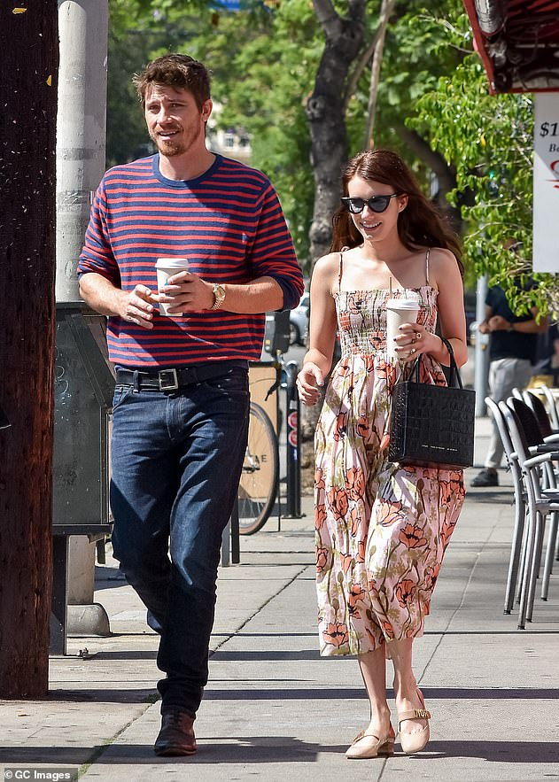 New love: Emma and Garrett were first linked in March 2019, following her breakup from AHS star Evan Peters, 33. She announced that the new couple were expecting a boy; shown June 2019