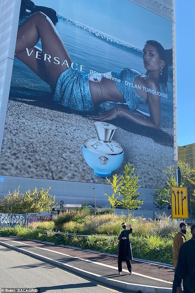 Billboard: The model put on a stylish display as she posed for pictures in front a large billboard of her fronting a Versace perfume campaign
