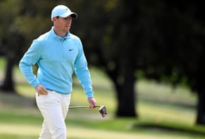 Rory McIlroy walks up onto the first green.