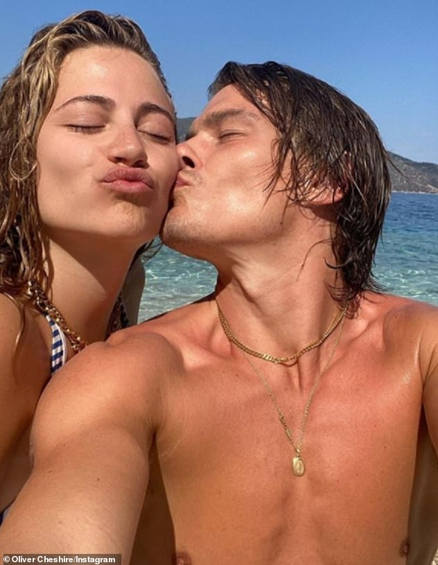 Special moments:Pixie proved her summer wasn't entirely wasted on Thursday as she gave fans an update on her romantic Greek holiday with model Oliver Cheshire