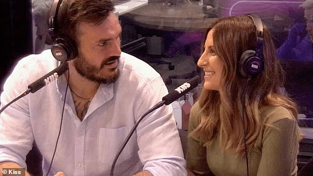 The perfect match: Dating guru Holly Bartter analysed footage of the pair in the KIIS FM studio and concluded they 'look really in sync'. The fact their arms were folded at the start - which can be a sign of conflict - was most likely just them feeling nervous about the interview, she said