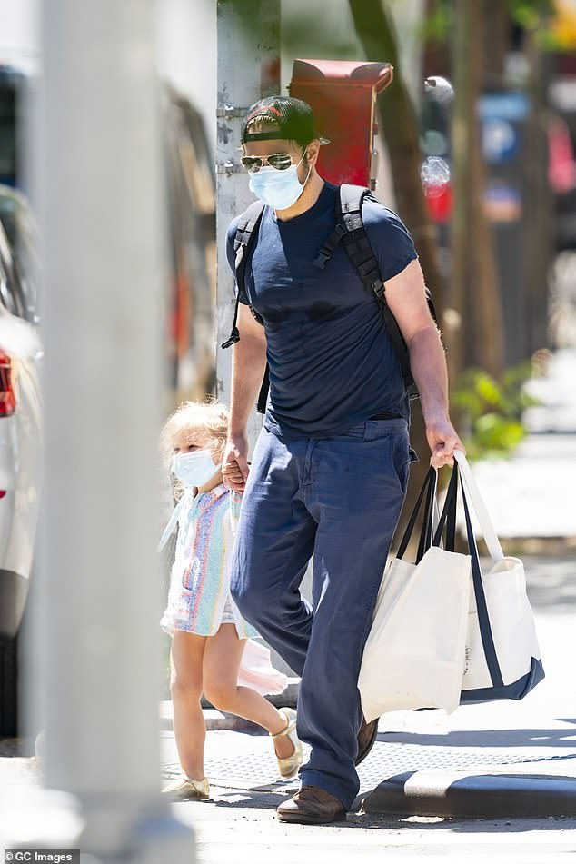 Doting dad: Cooper and his three-year-old daughter enjoyed a day in New York City in June