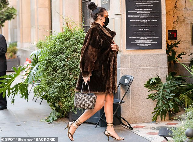 Legs for days: The 32-year-old showed off her toned stems in some brown snakeskin wraparound gladiator stilettos and a diamond anklet