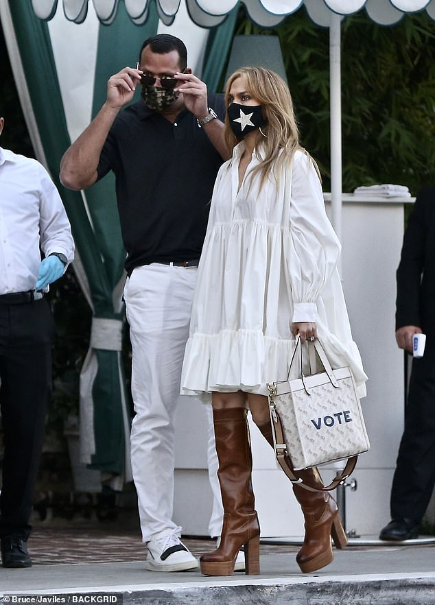 Rock the vote:The 51-year-old megastar carried a white leather Gucci bag that had 'Vote' embroidered on the front of it