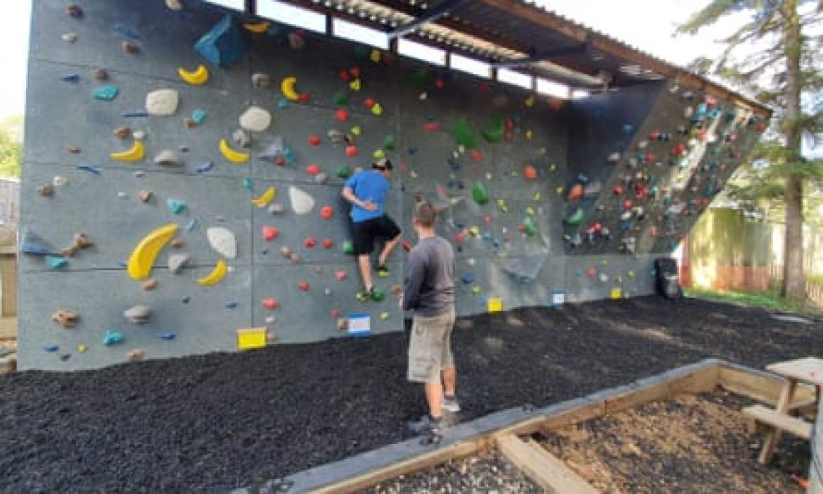 Outdoor bouldering wall at Far Peak adventure hub in the Cotswolds, UK.
