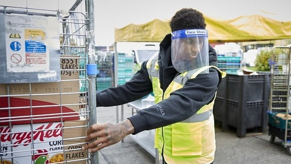 Footballer Marcus Rashford helping out at the FareShare food charity in Manchester