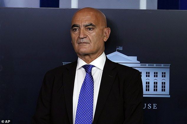 Dr Moncef Slaoui, the chief of Operation Warp Speed, says he expects two paused coronavirus trials to resume this week. Pictured: Slaoui stands on the podium before President Donald Trump speaks during a news conference at the White House, September 18