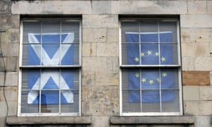The Scottish Saltire and the EU flag hanging in windows of a flat in Edinburgh.
