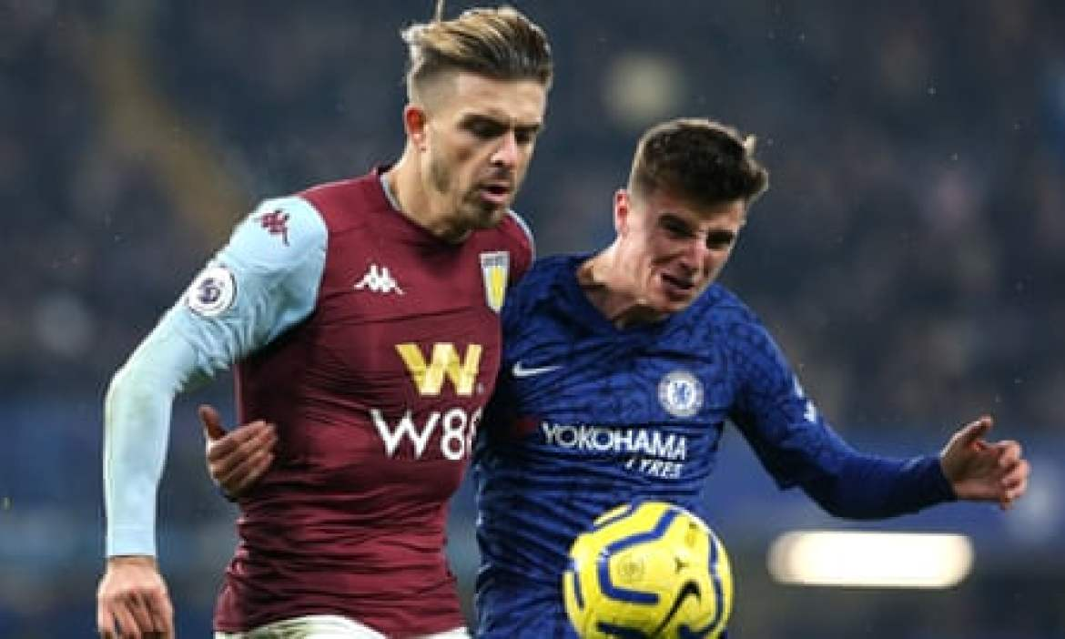 Jack Grealish of Aston Villa (left) and Mason Mount of Chelsea battle for the ball.
