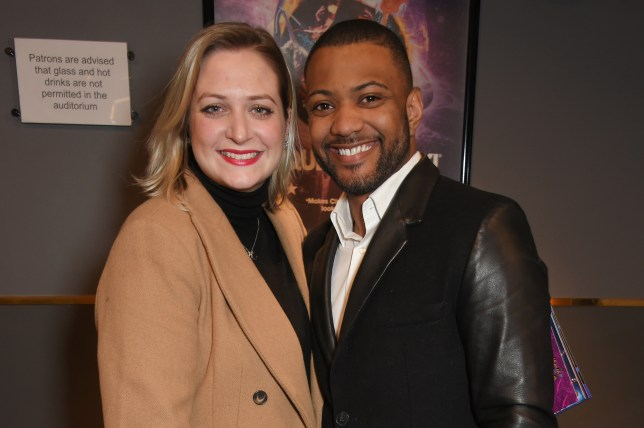 JB Gill and wife Chloe posing on red carpet