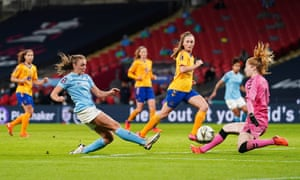 Georgia Stanway shoots past the Everton goalkeeper Sandy MacIver to scores Manchester City's second goal.
