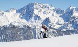 Teenage girl carrying snowboard