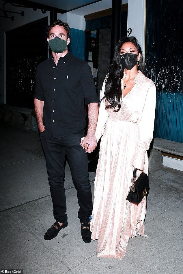 Loved-up: Nicole Scherzinger and her boyfriend Thom Evans seemed to be closer than ever as they celebrated their first anniversary in Beverley Hills on Friday evening