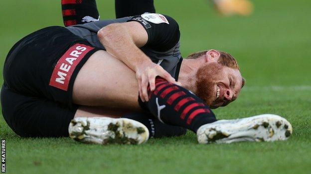 Rotherham United midfielder Shaun MacDonald injured against Stoke