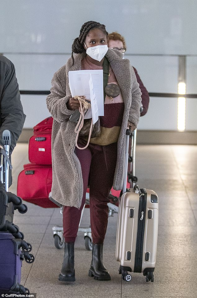 Flying:Strictly Come Dancing judge Motsi Mabuse has revealed that she flew home to Germany after her dance school was 'targeted' (pictured at Heathrow on November 10)