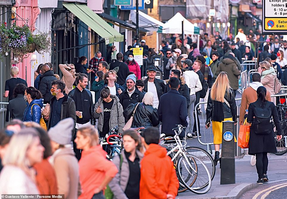 The Prime Minister reluctantly signed off a new lockdown in England after being warned by Government scientists that deaths could rise to 4,000 a day (people during lockdown in London, pictured)