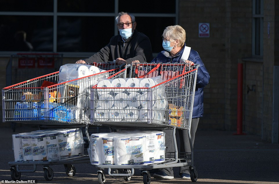 Last minute shoppers stock up on essentials before lockdown at Costco cash and carry at the Lakeside retail park in West Thurrock