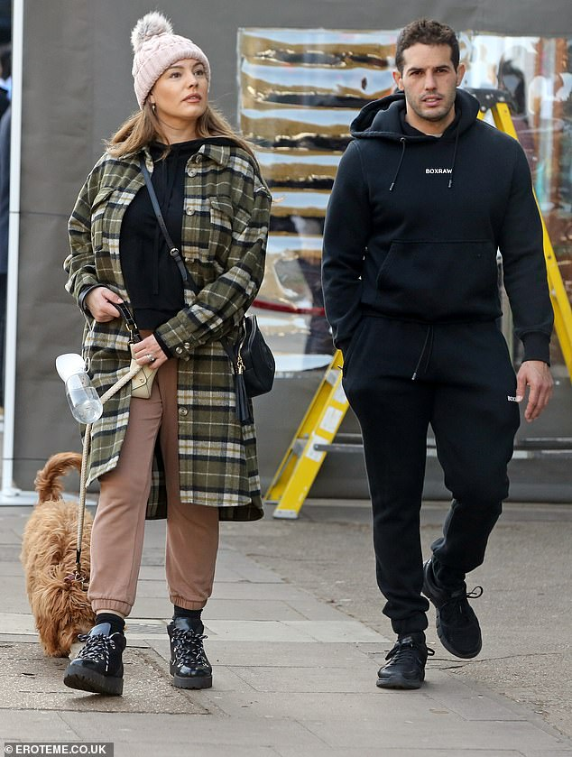 Couple outing: The former glamour model, 40, strolled through Hampstead, London, with her partner of five-years, Jeremy Parisi, and their five-month-old puppy, Teddy
