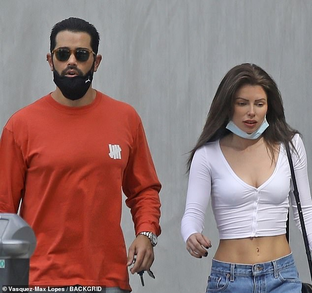 Uncovered: Neither the 41-year-old SAG Award winner nor his belly-baring companion were wearing their face masks properly as coronavirus numbers spike nationwide