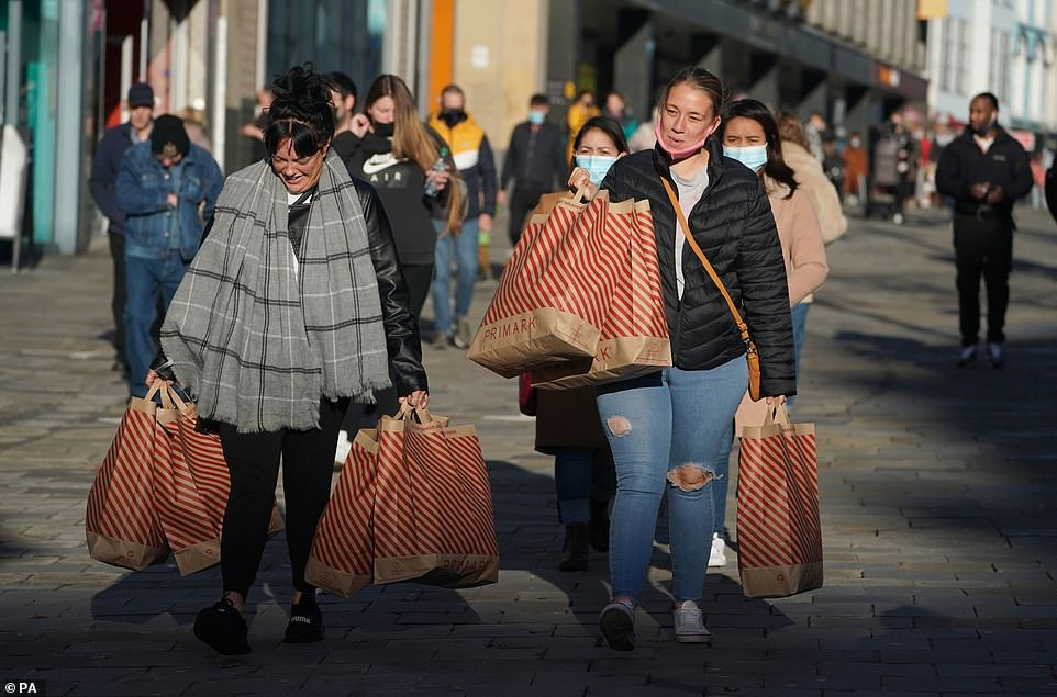 Shoppers in Northumberland Street in Newcastle hit the stores as they opened this morning
