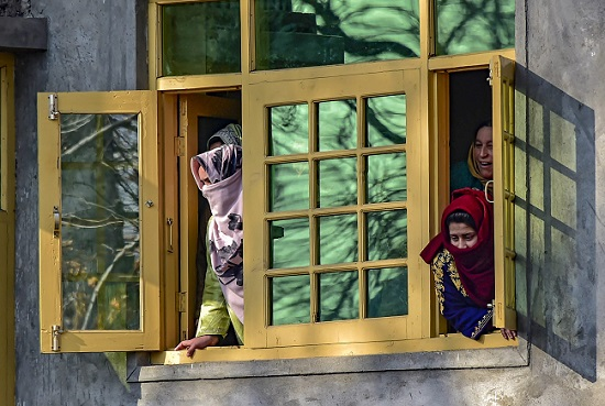 Kashmiri women look through a window in Pulwama, South Kashmir. (Photo: PTI) (Image used for representation purpose only)