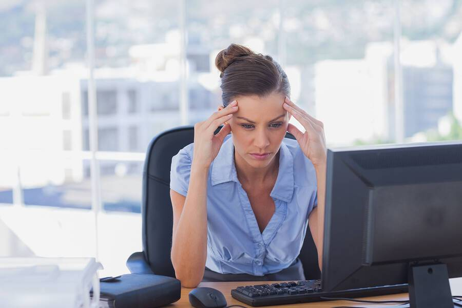 bigstock-Overworked-businesswoman-in-th-46619533