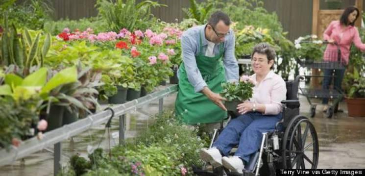 Florist helping customer seated in wheelchair