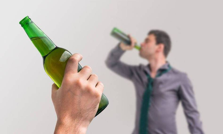 bigstock-Unfocused-Man-Drinking-Alcohol-139649423
