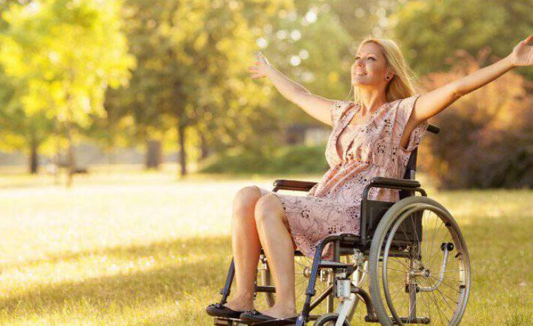 o-person-smiling-in-wheelchair-facebook-710x434
