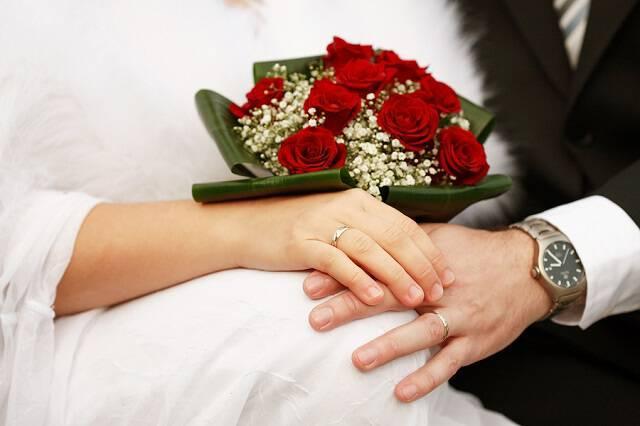 bigstock Detail of hands of wedding cou 26010533