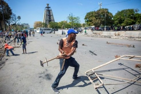Two Servicemen Dead, Scores Injured As Protesting Haiti Police Attack Army HQ