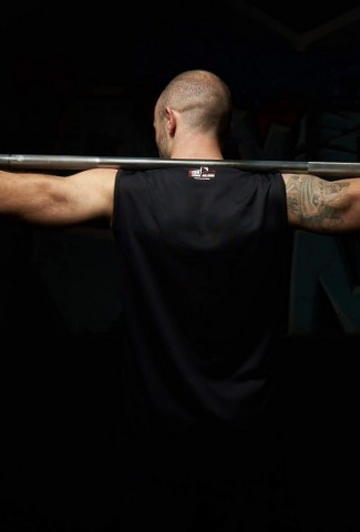 Workout Quotes for Men Man Holding Barbell Behind His Neck