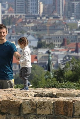 Herbalife Immune Health Products Man Holding HIs Child's Hand Walking Along a Stone Wall