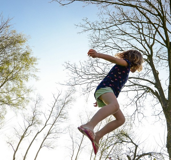 Herbalife Children's Health Products Kid Jumping in the Air