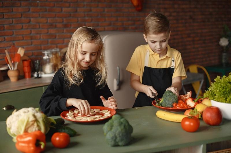 Herbalife Children's Health Products Two Children in a Kitchen Preparing Fruit